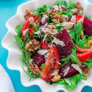 Baked beetroot with toasted walnuts, tomatoes, Parmesan cheese and arugula. ? tgncooking.com