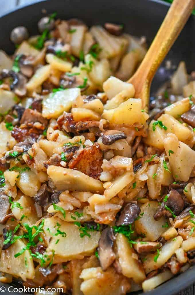 Potatoes with Mushrooms on a wooden spoon