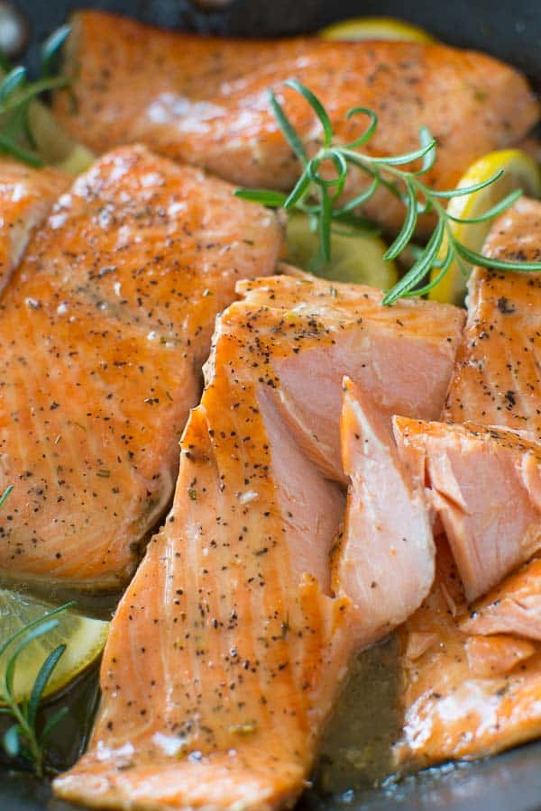 Flaky salmon cooked to perfection in rich Lemon Rosemary sauce. Ready in 15 minutes! ? tgncooking.com
