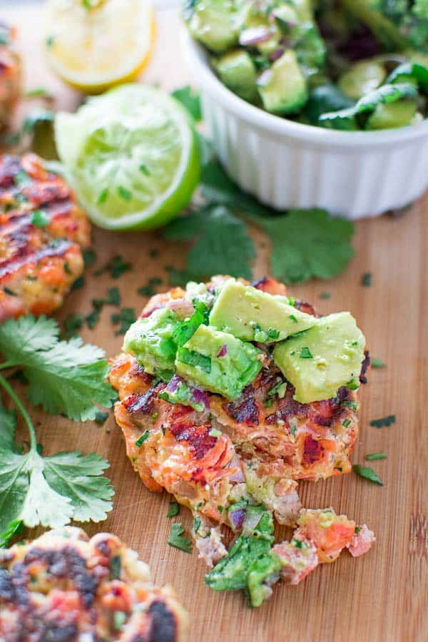 This tasty and easy Salmon Burger recipe is not to be missed! Ditch the bun and serve it with mouthwatering Avocado Salsa. ? tgncooking.com