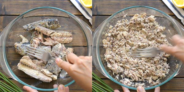 Flaking mackerel meat with fork