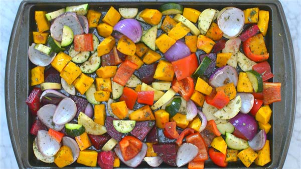 mixing the vegetables with seasoning