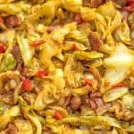 This Fried Cabbage recipe is insanely good! Made with bacon, onion, bell pepper, and a touch of hot sauce, it is easy to make, simple, and comes out perfect every time! ? tgncooking.com #cabbage #bacon #fall #onepot #dinner