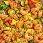 This Easy Shrimp and Vegetable Skillet makes a healthy, quick, and delicious dinner! Packed with wild-caught shrimp, tender zucchini, and sweet bell peppers, it is going to become your favorite seafood dish!