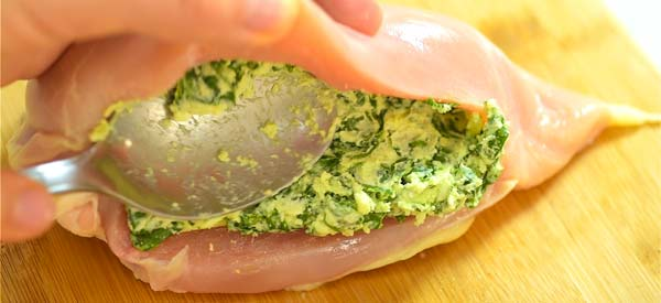 stuffing the chicken with spinach mixture