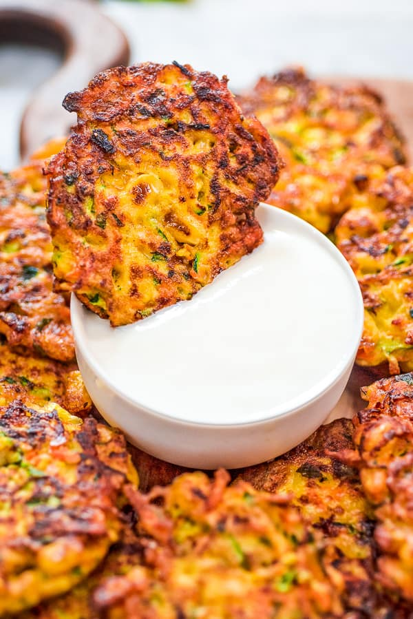 vegetable fritter in a cup with sour cream
