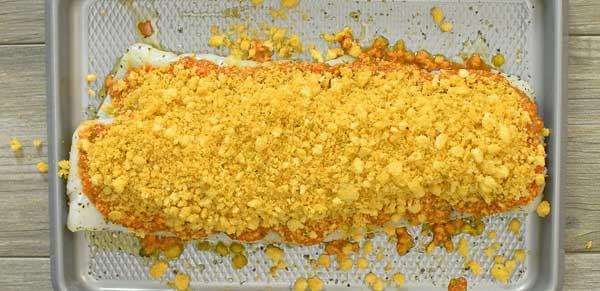 topping the cod fish with breadcrumbs