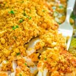 This Baked Cod recipe is truly the best you can find! Perfectly-seasoned cod, covered with a layer of roasted pepper sauce and topped with crispy breadcrumbs. #cod #fish #seafood #bakedfish #dinner #recipeoftheday