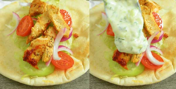 assembling chicken gyro on a pita. Topping it with lettuce, tomatoes, cucumbers, onions, and tzatziki.