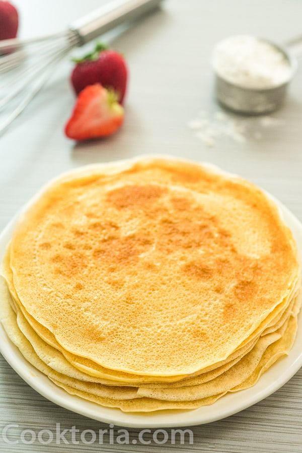 vegan crepes with whisk on the background