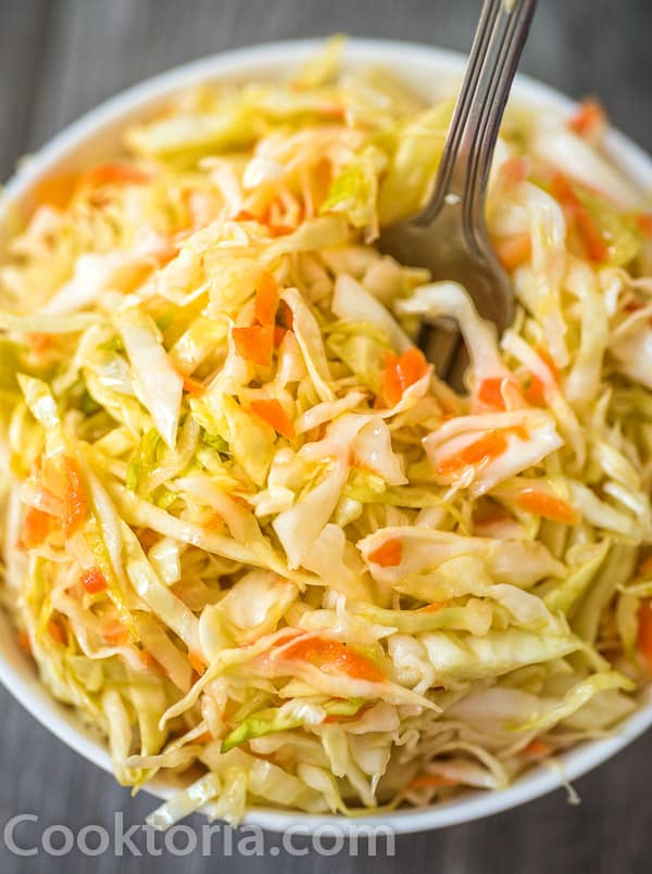 Pickled Cabbage in a bowl with a fork in it