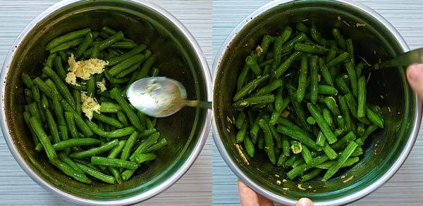 adding garlic and oil to the green beans