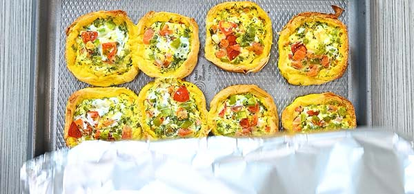 covering egg cups with foil and baking again