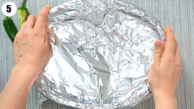 covering the rice with aluminum foil