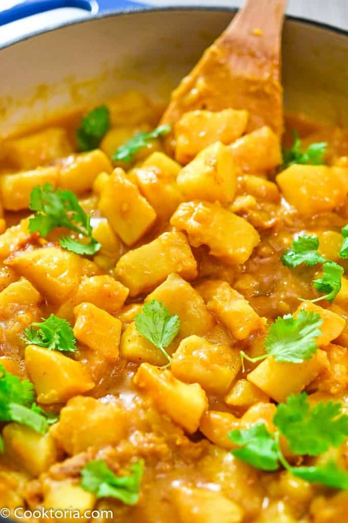 Potato Curry on a wooden spoon