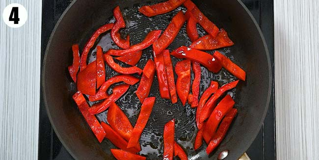 cooking bell peppers in the skillet