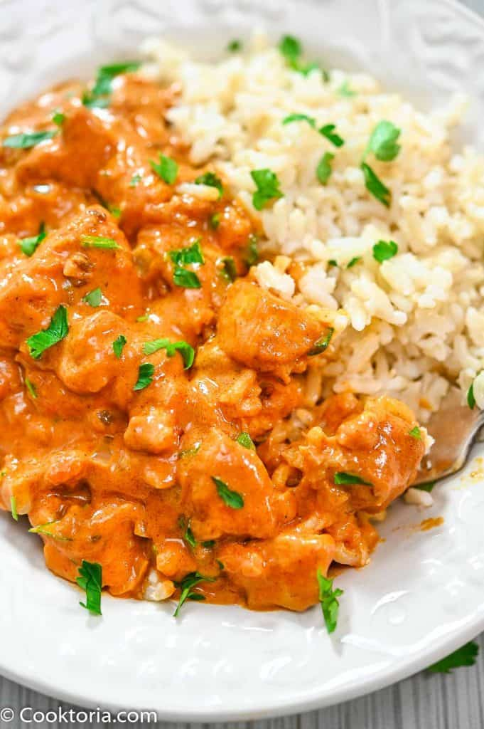 Tofu with Indian Sauce in a plate with brown rice on the side