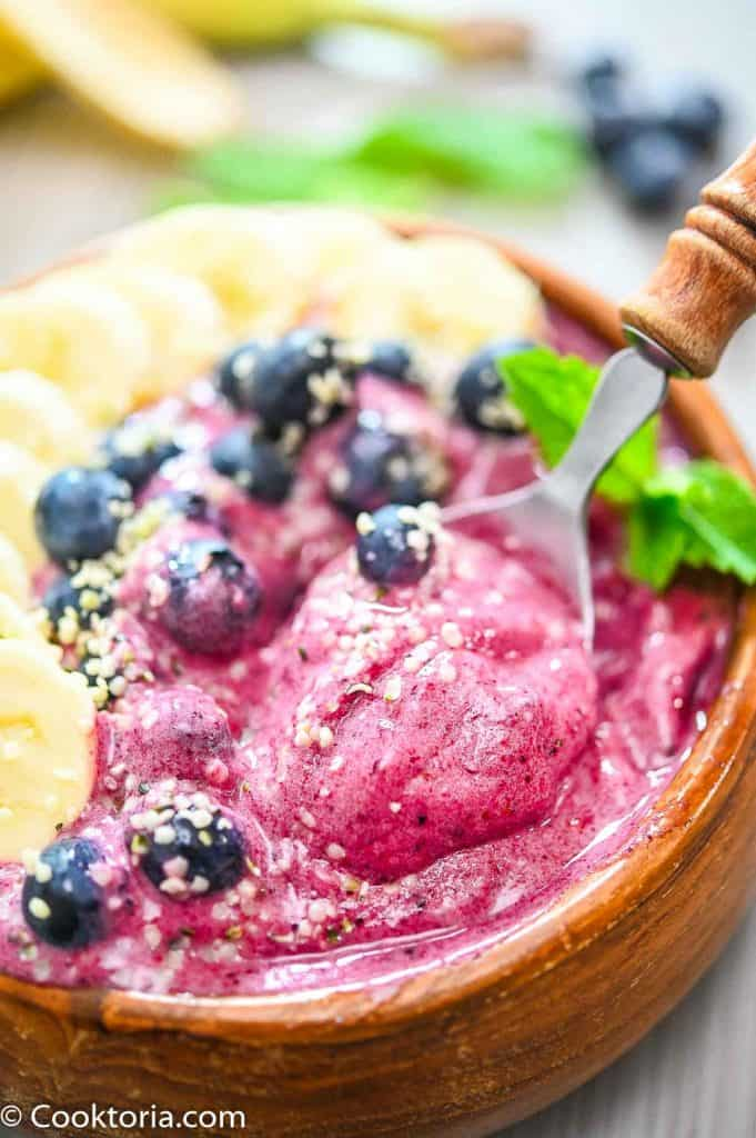 Banana Berry Smoothie Bowl on a spoon