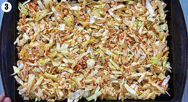 spreading the cabbage on a baking sheet