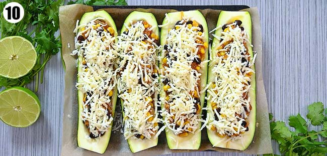 topping zucchini boats with cheese