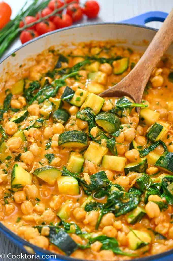 Zucchini Chickpea Curry on a wooden spoon