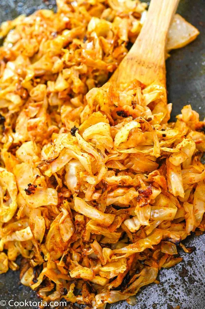 Baked Cabbage on a wooden spoon