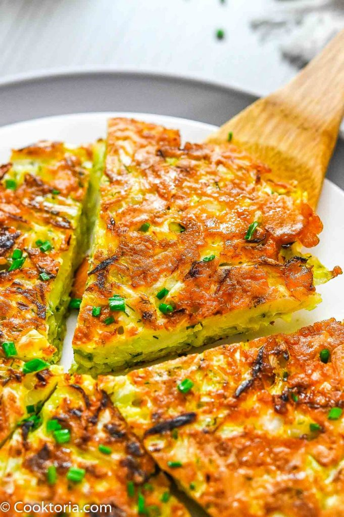 Cabbage Pancake on a wooden spoon