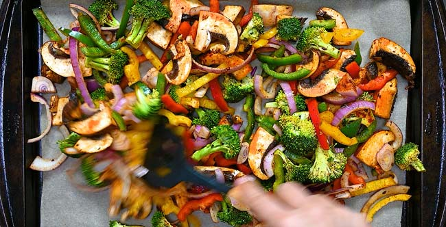 spreading the vegetables on a tray