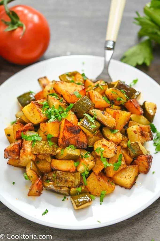 Potatoes and Zucchini on a white plate