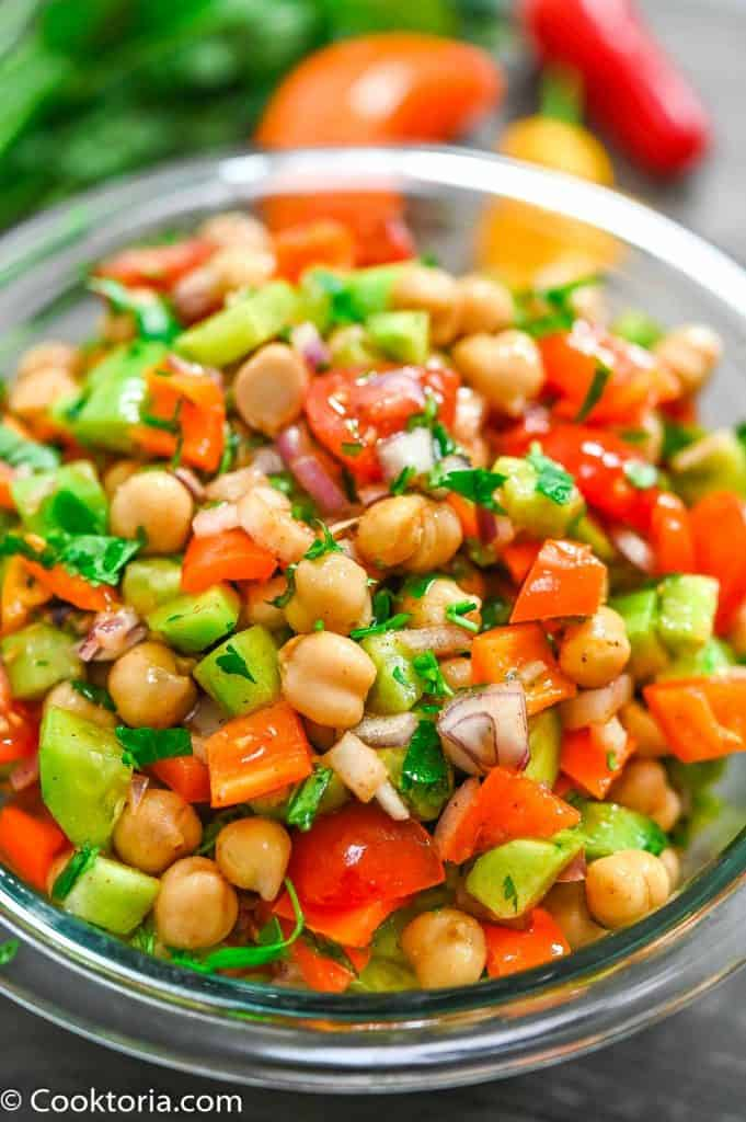Chickpea Salad with veggies on the background
